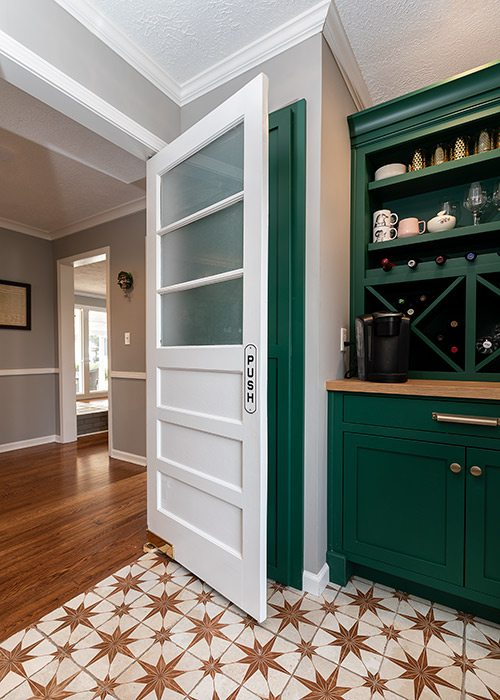 Modern green kitchen cabinets in colonial home Springfield MO
