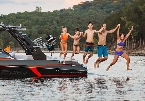 The Morgans leaping into Table Rock Lake