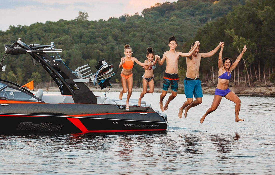 The Morgan family jumping into Table Rock Lake