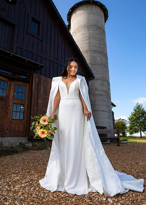 Ivory Diana gown and wedding cape from The Dress in Springfield MO