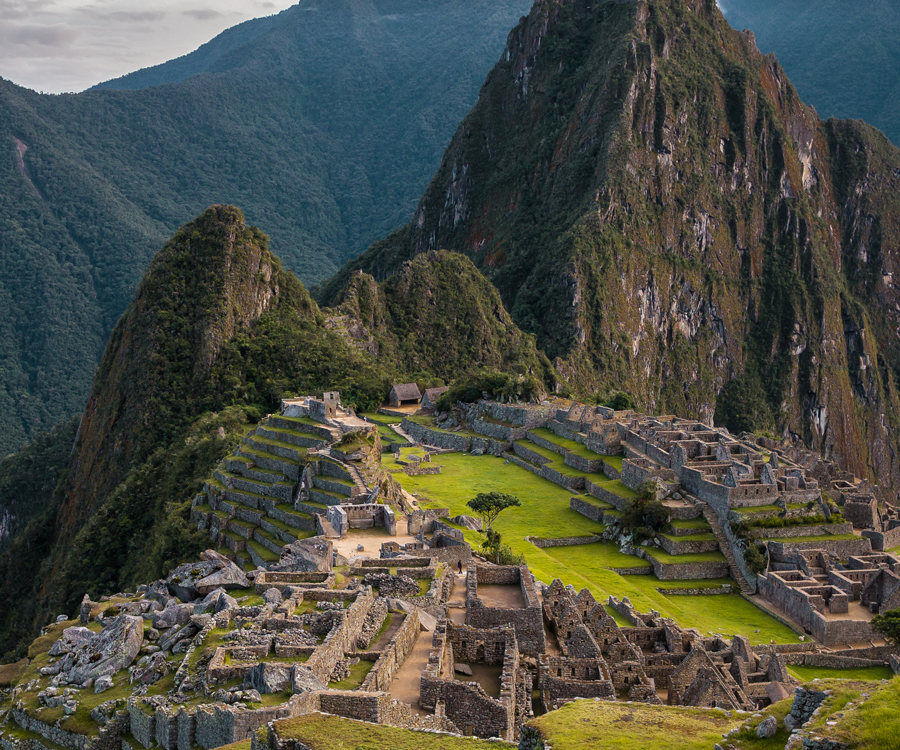 Machu Picchu ruins are located high up in the mountains in Peru.