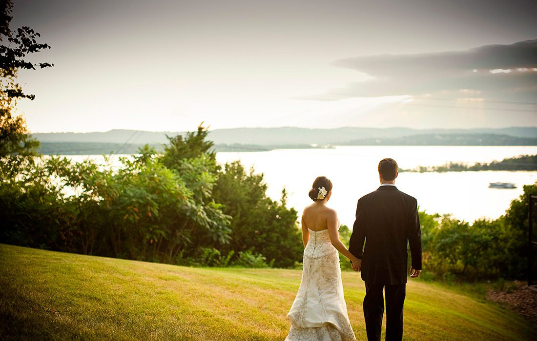 Bride and groom overlooking Table Rock Lake at Chateau on the Lake in Branson MO