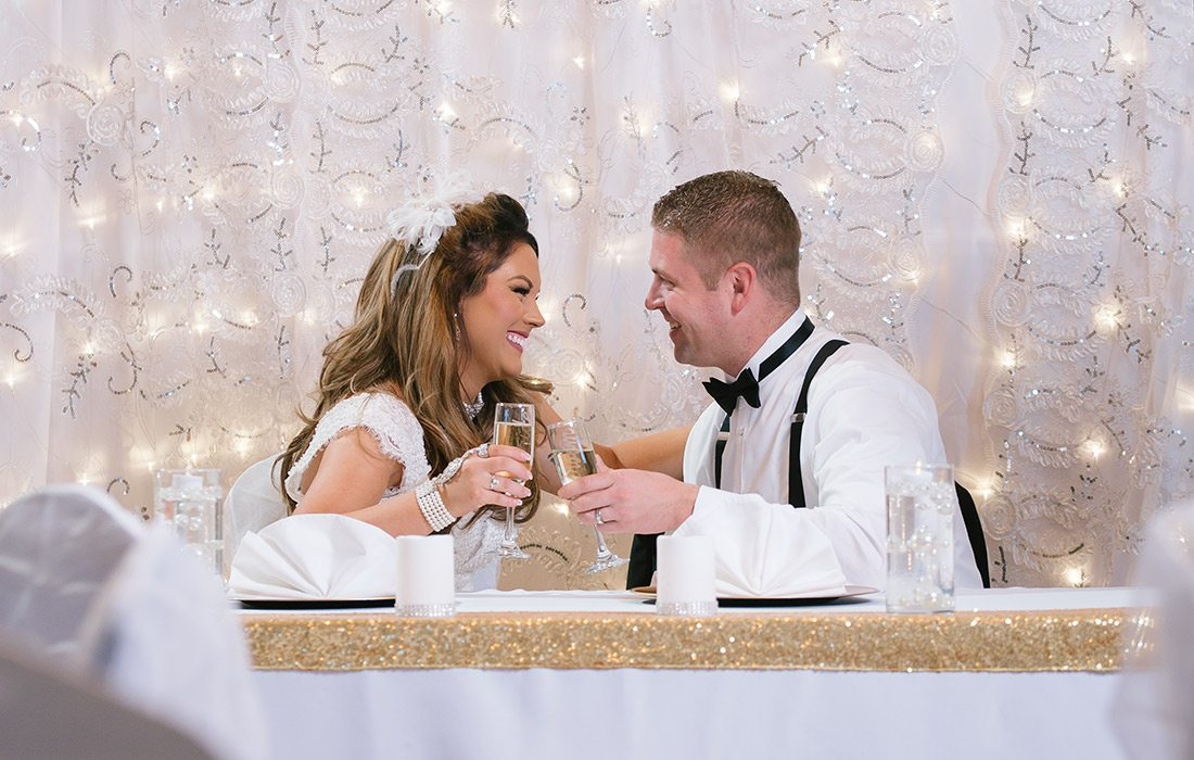 Bride and groom sharing a champagne toast at Pointe Royale Golf Village in Branson MO