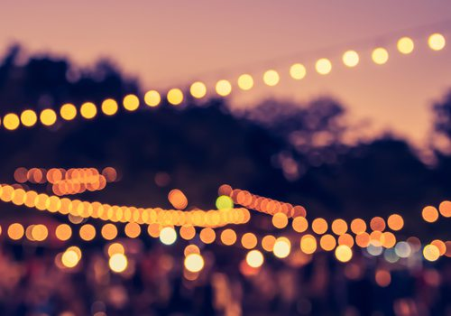 glowing string lights at sunset
