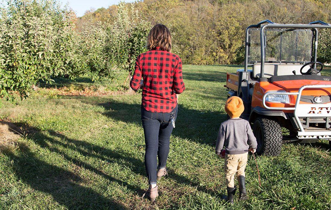 mother and son at apple orchard