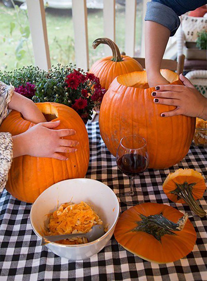 people carving pumpkins