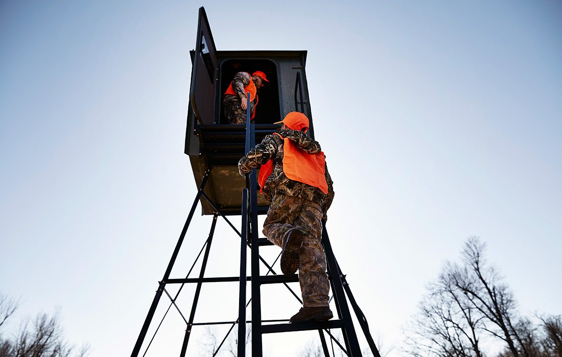 guys getting into a deer stand