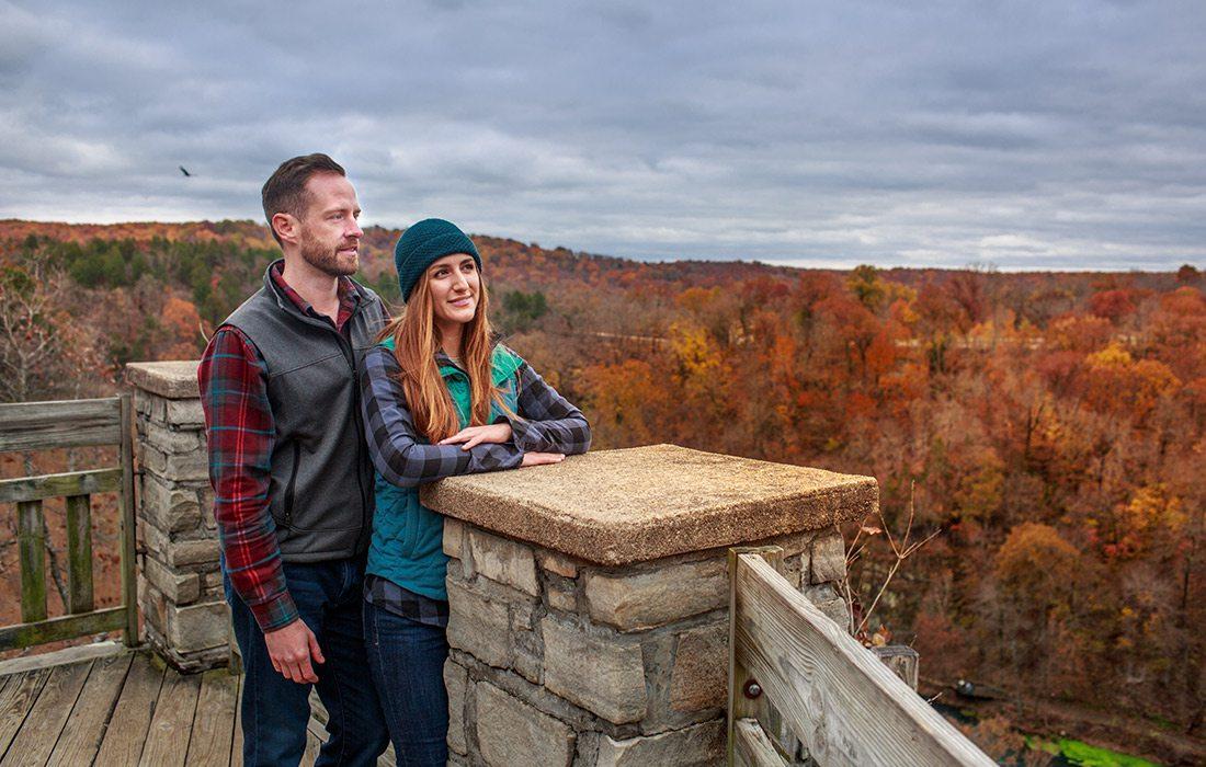 Young couple at an outlook stop along the Ha Ha Tonka loop trail in Camdenton, Missouri