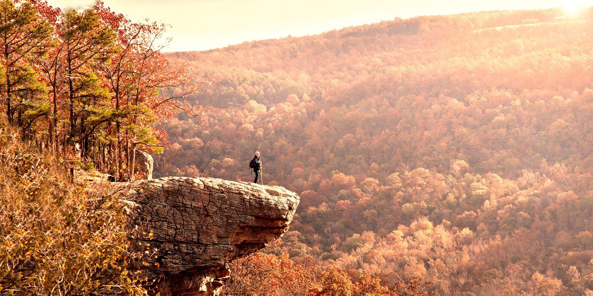 Man on a rock ledge along Hawksbill Crag in Arkansas
