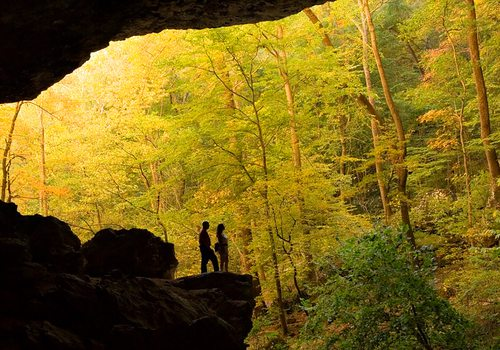Couple silhouetted in Edens Fall Cave