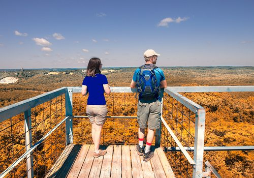 Couple at an overlook along the Glade Trail in the Ruth and Paul Henning Conservation Area