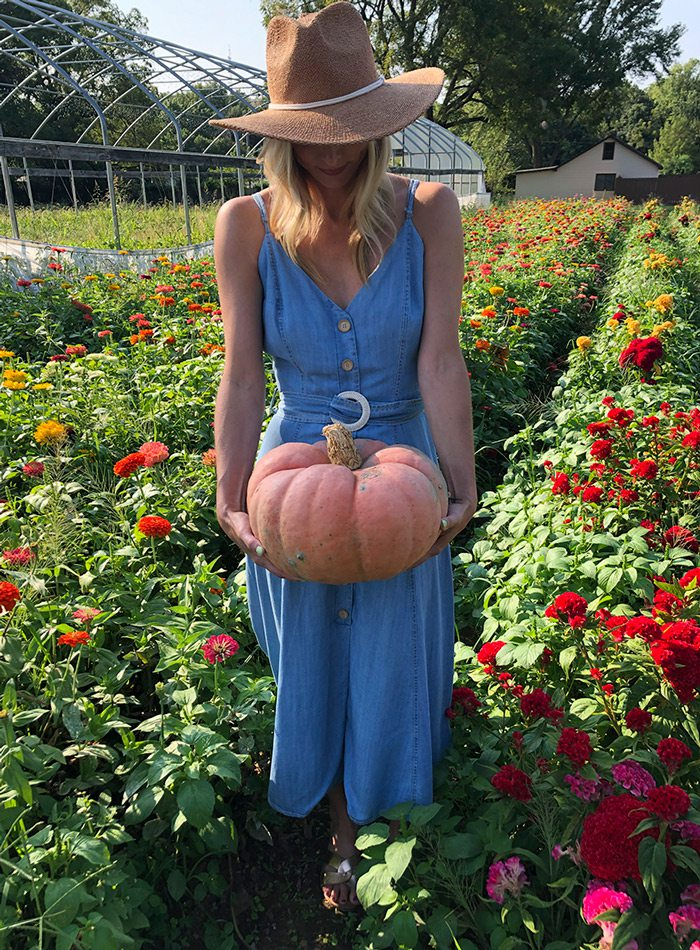 Heather Kane carrying pumpkin.