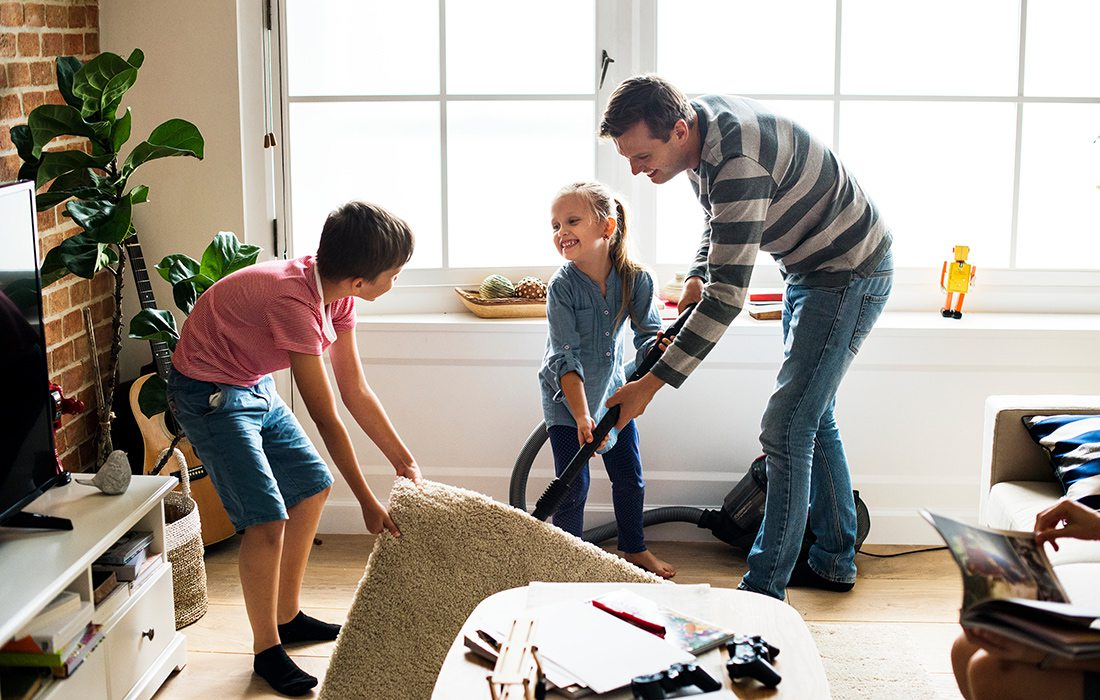 Father and kids cleaning at home