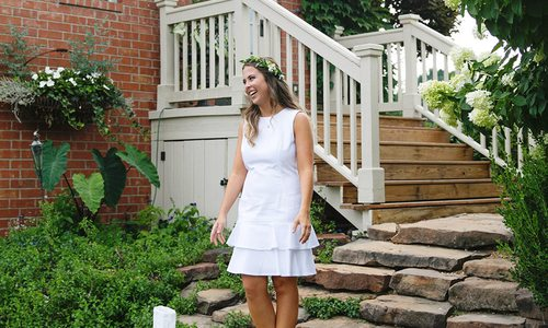 Katelyn Reynolds in white dress on steps
