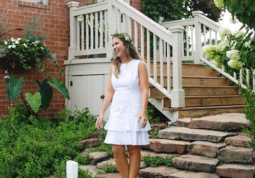 Katelyn Reynolds in white dress on steps