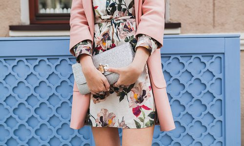 Woman in a floral dress and pink coat