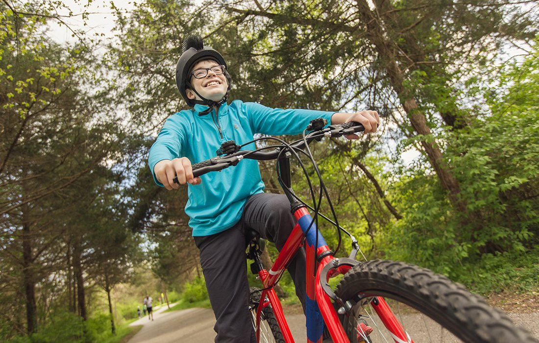 Young boy riding a bike on the Galloway Trail
