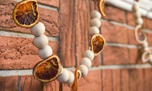 Beaded orange garland made by Heather Kane