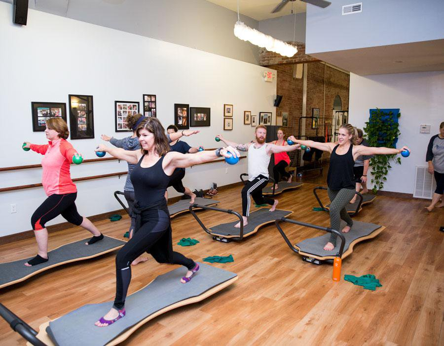 Participants move their Juvo Boards from the balance position to the elevate position for different exercises.