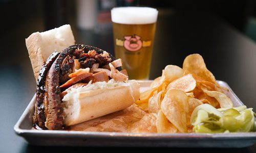 BBQ sandwich with chips and a beer at Gettin' Basted in Branson MO