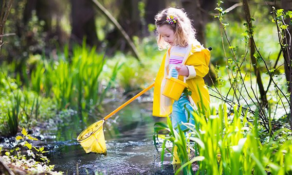 Girl fishing in a pond outdoors.