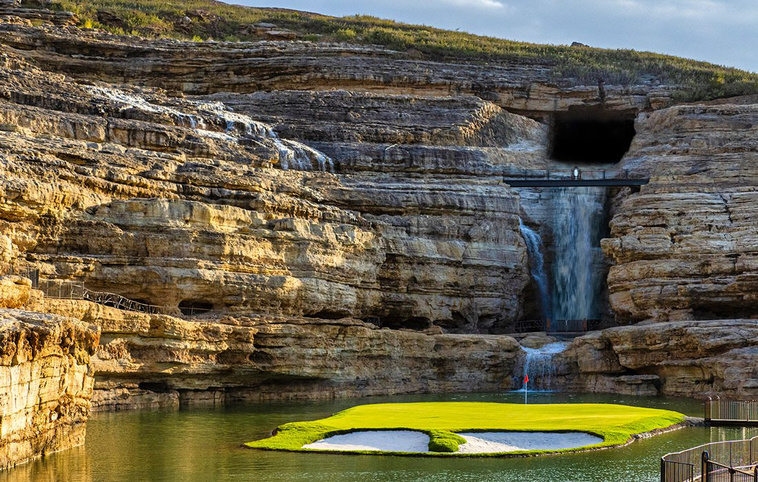 19th hole at Payne's Valley Golf Course featuring a waterfall and an island green