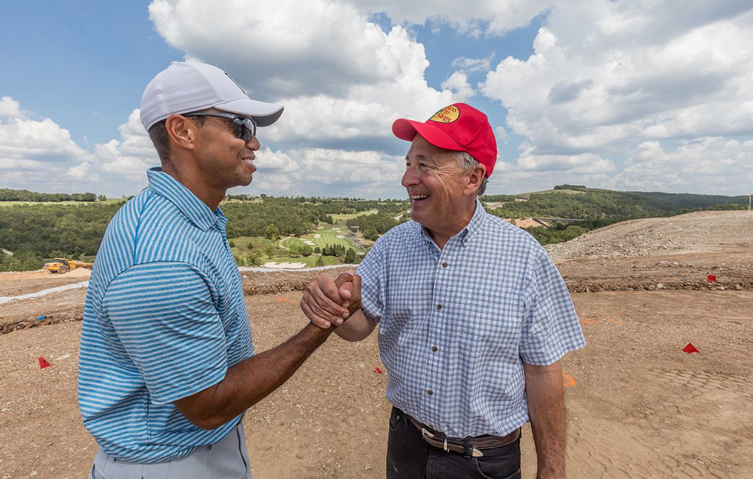 Tiger Woods and Johnny Morris