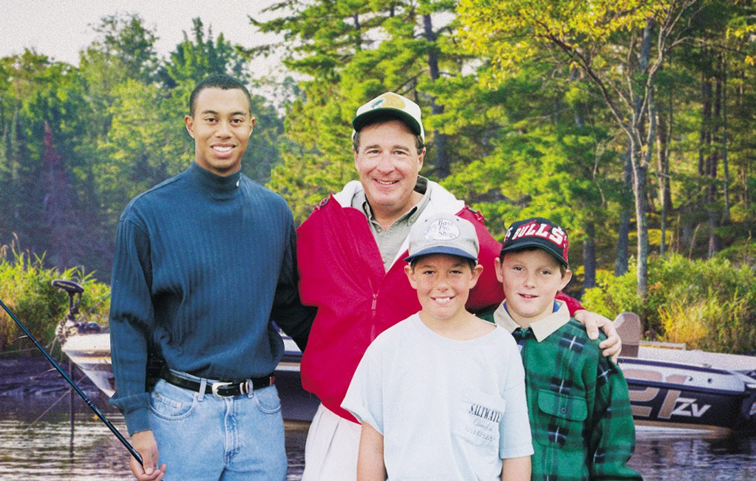 Tiger Woods and Johnny Morris on a fishing trip some 20 years ago with Morris' son, John Paul (left), and a friend