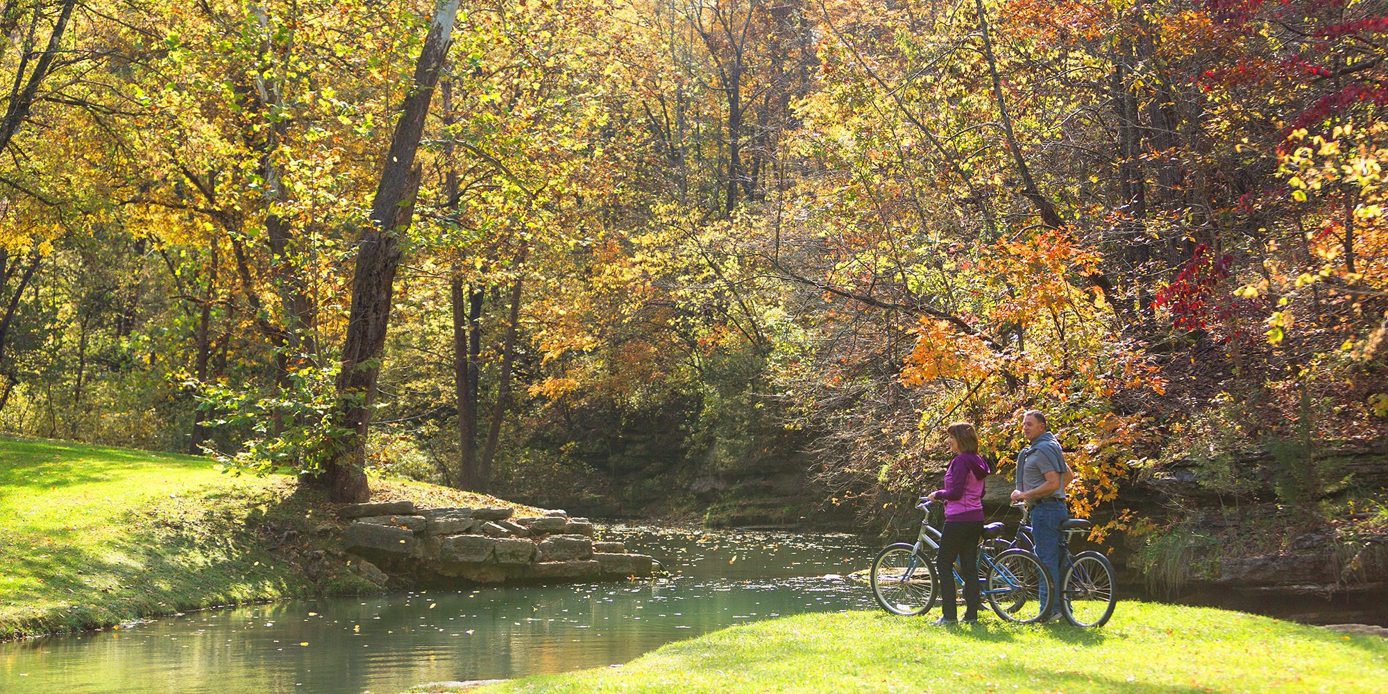 Couple biking at Dogwood Canyon