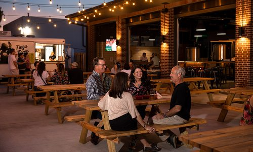Groups of people drinking beers on the patio at Hold Fast Brewing in Springfield MO