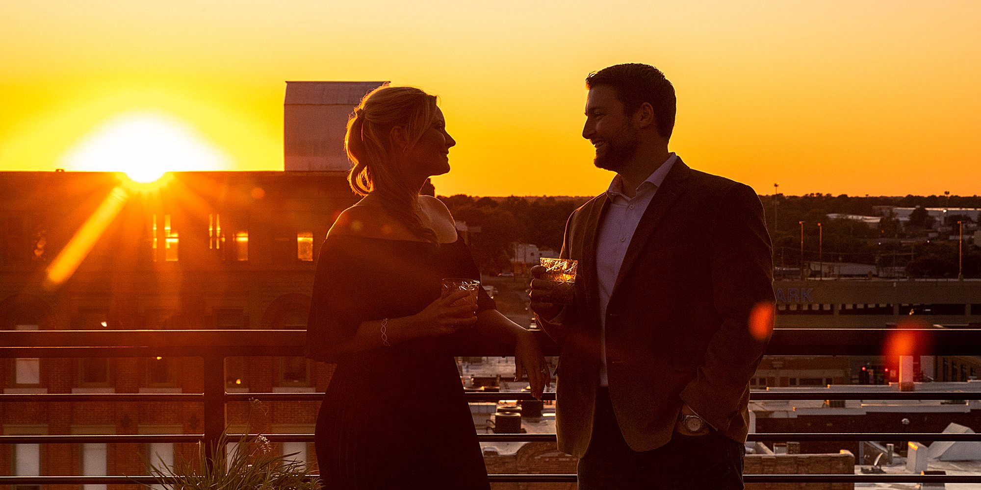 Couple enjoying a Springfield MO sunset from Vantage Rooftop Lounge