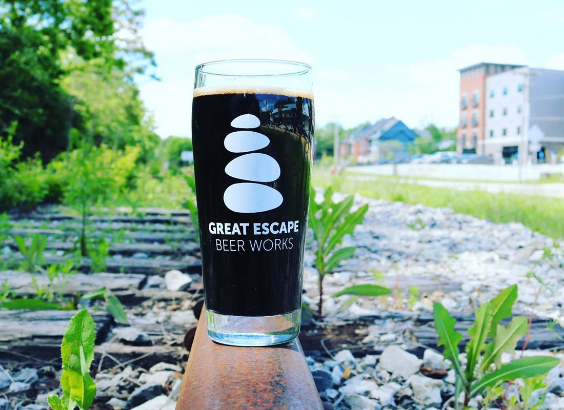 Great Escape Beer Works stout beer on train tracks in Galloway