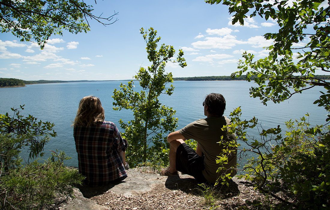 Couple takes a break on the Lakeview Trail in Dadeville Missouri