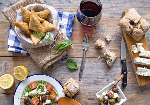 Greek food on a wooden tabletop