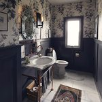 Slider Thumbnail: Copper sink in navy and floral bathroom with wallpaper by Adrian Rhoads.
