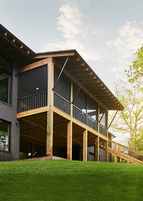 Screened in porch of rustic midcentury modern home in southwest Missouri