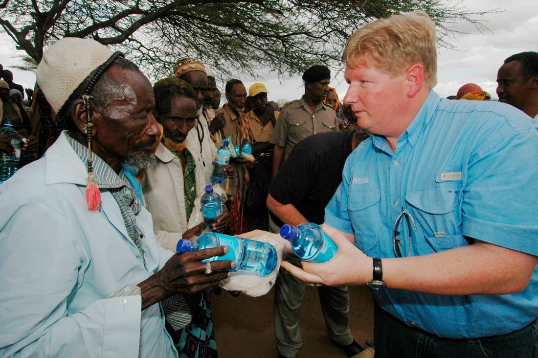 Hal Donaldson helps distribute water courtesy Convoy of Hope