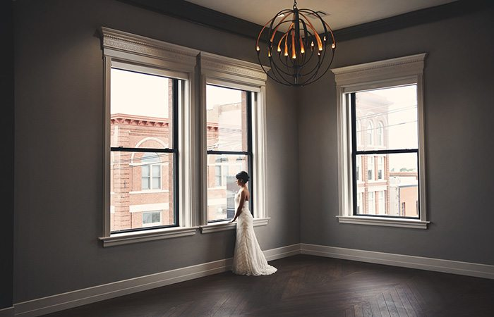bride by large windows