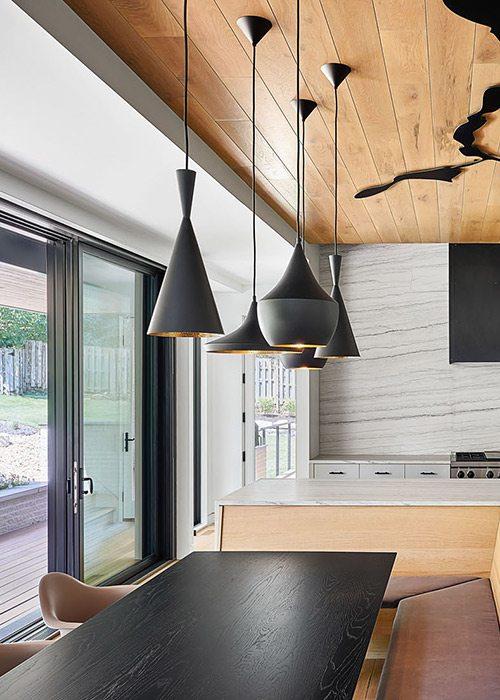 Modern kitchen design in a southwest Missouri home designed by Kansas City based Hufft