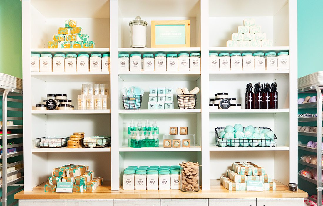 White shelves with Buff City Soaps products