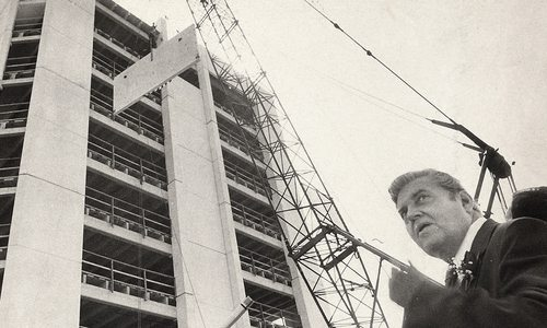 John Q. Hammons in front of the University Plaza construction site