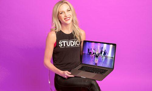 Jamie Kinkeade holding laptop with footage from The Studio