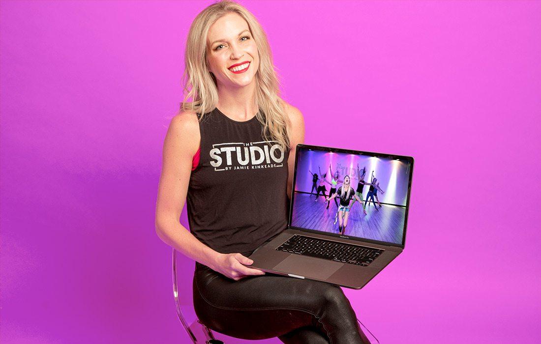 Jamie Kinkeade holding laptop showing screen from The Studio