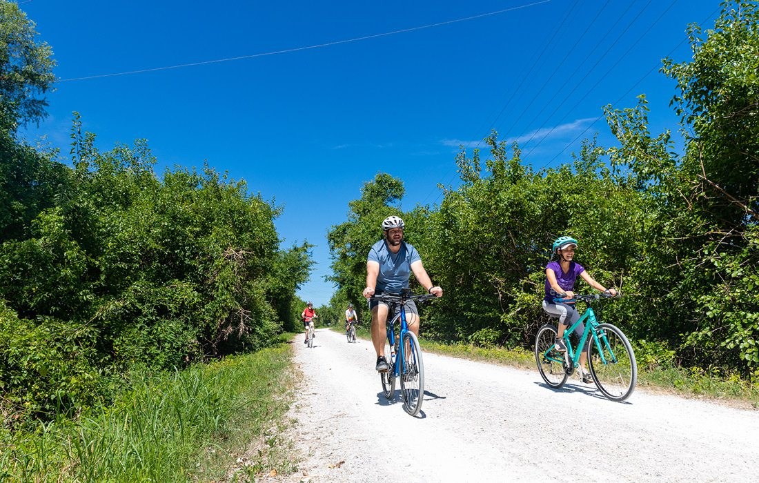 People cycling on a trail in Jefferson City, MO