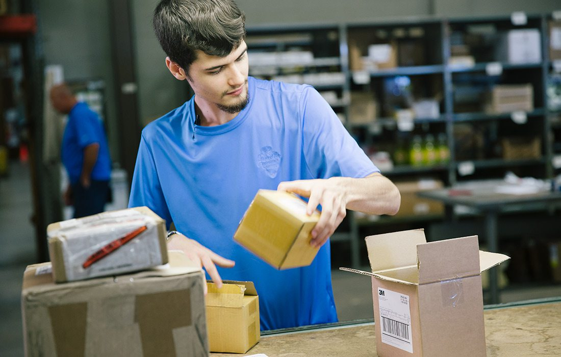 Young man packaging at Johnston Industrial Supply in Springfield MO