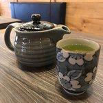 Slider Thumbnail: Green tea in pretty tea pot and glass