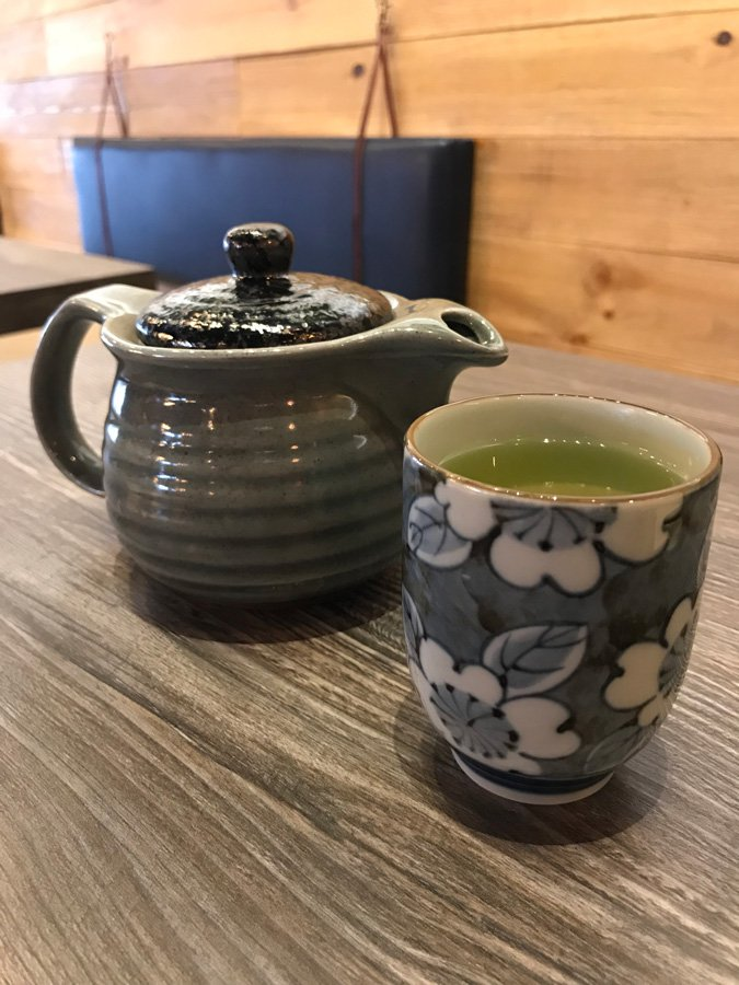 Green tea in pretty tea pot and glass