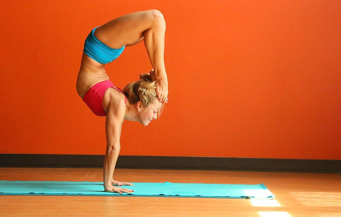 Kino MacGregor yoga pose