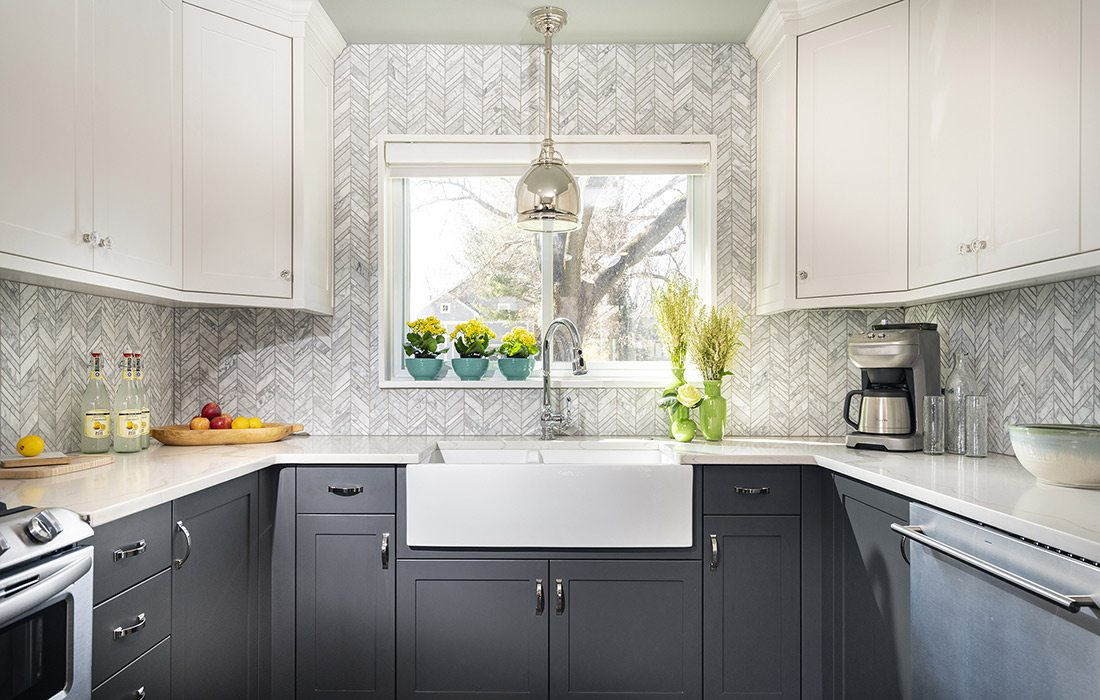 White and grey chevron kitchen tile backsplash