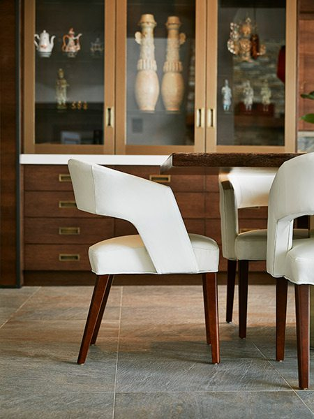 White barrel-back chair at midcentury design dining room table